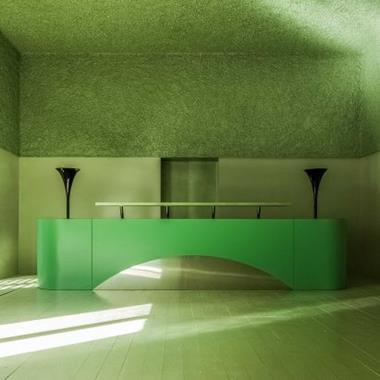 Antonino Cardillo bases textured all-green gallery interior on Wagner opera